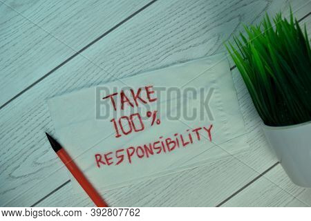 Take 100% Responsibility Write On Tissue Isolated On Wooden Table. Selective Focus On Take 100% Resp