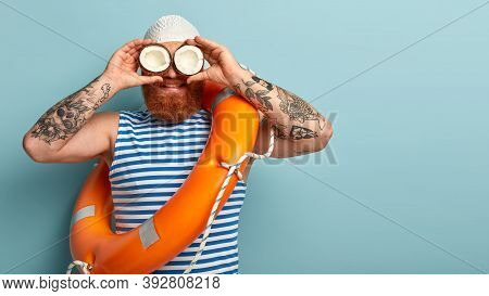 Male Safeguard Supervises Situation On Sea, Holds Two Coconuts On Eyes Instead Of Binoculars, Wears