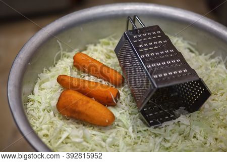 Shredded Cabbage, Shredder, Carrots. Large Bowl Of Chopped Cabbage. Preparing Cabbage Before Sourdou