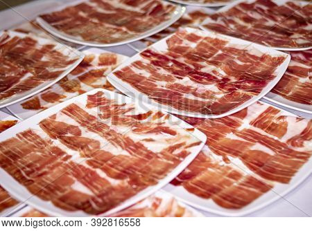 Catering Service. Dishes And Portions Of Iberian Ham And Serrano Ham At A Social Event