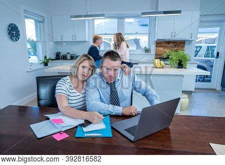 Covid-19 Outbreak Impact On Housing Finance. Worried And Stressed Couple Not Able To Pay Bills, Mort