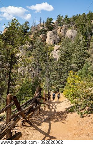 Manitou Springs, Colorado - September 15, 2020: Hikers Make Their Way Down The Barr Trail, From The