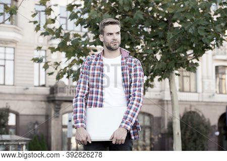 Freelance Blog Writer Online. Freelancer Hold Laptop Urban Outdoor. Freelance Worker In Casual Style