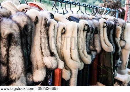 A Bunch Of Traditional Ukrainian Fur Vests Hanging For Sale In An Outdoor Store In A Rural Village I
