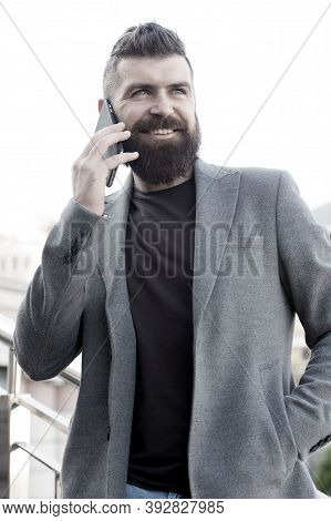 Share Information By Verbal Communication. Bearded Man Has Business Talks On Smartphone. Business Co