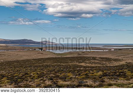 Falkland Islands, Uk - December 15, 2008: Wide Windswept Bare Landscape Of Dry Land With An Isolated
