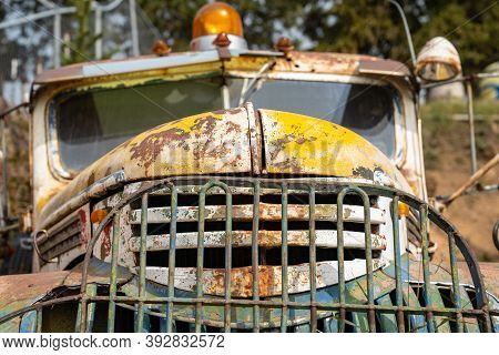 Colorful Old Rusty Vintage Car, Abandoned And Neglected