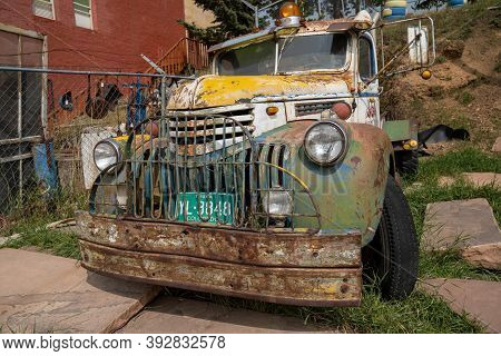 Victor, Colorado - September 17, 2020: Colorful Old Rusty Vintage Car, Abandoned And Neglected
