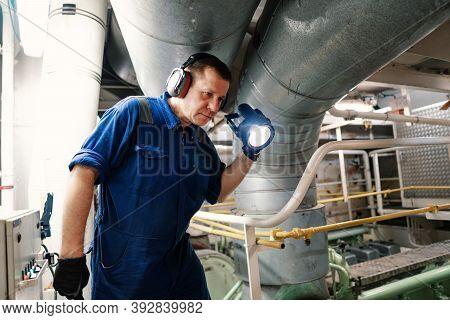 Marine Engineer Officer Controlling Vessel Enginesand Propulsion In Engine Control Room Ecr