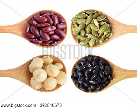 Red Beans, Black Beans, Pumpkin Seeds And Macadamia Isolated On White