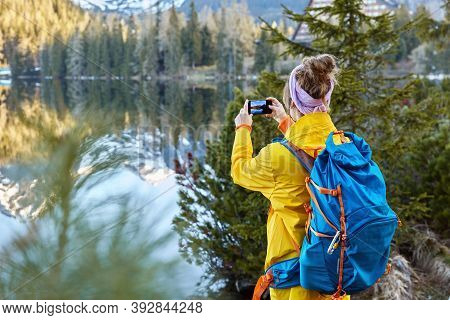 Freedom Traveler Takes Pictures Of Scenic Nature View, Tries To Capture Beautiful Lake With Mountain