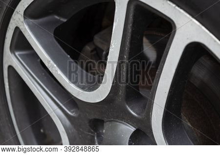 Wheel Rim With Scratches And Dirt. Scratches And Abrasions On The Cast Wheel Rim. Auto Parts Concept