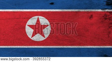 Flag Of North Korea On Wooden Plate Background. Grunge North Korean Flag Texture, Horizontal Red Whi