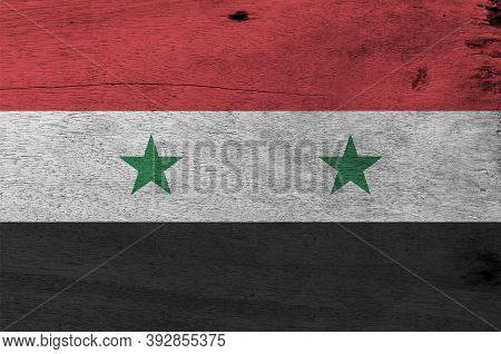 Flag Of Syrian Arab Republic On Wooden Plate Background. Grunge Syrian Arab Republic Flag Texture, A