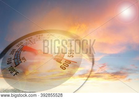Extreme temperature gauge in hot sky. Global warming idea. Climate change