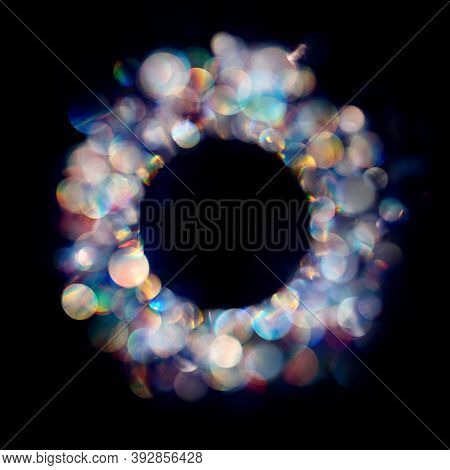 Multiple Neon Colored Iridescent Bokeh Spots In Round Frame.