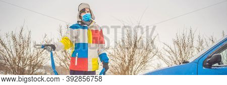 Man With Towing Rope Hooks Near Towed Car. Wear Medical Masks Due To The Covid-19 Coronavirus Banner