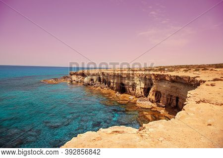 Rocky Beach At Sunset. Beautiful Nature Of Cyprus