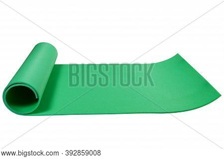 Green Mat Or Karemat, For Fitness Or For A Hike, Laid Out On A White Background