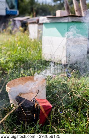 Old Manual Smoker For Apiary Beekeeper Work. Fumigation Honeycomb With Bees. The Theme Of Beekeeping