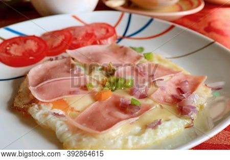 Delectable Homemade Fried Eggs With Ham And Chopped Vegetable
