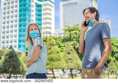 Social Distancing Concept. A Man On The Street Violates Social Distance In Line, Wears A Mask Incorr
