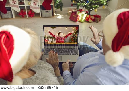 Grandparents In Santa Caps Video Calling Their Happy Little Grandson On Christmas Day