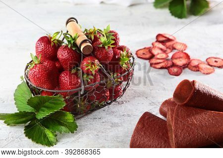 Strawberries In A Wicker Metal Basket And Strawberry Marshmallows On A Poor Background. View From Ab