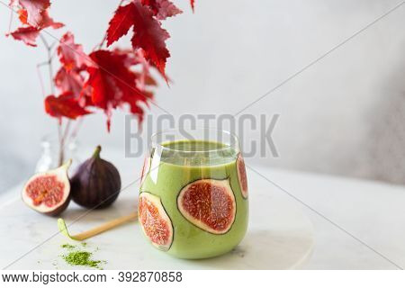 Matcha Green Tea Breakfast Superfoods Smoothie With Figs In A Glass. Side View, Copy Space For Text.