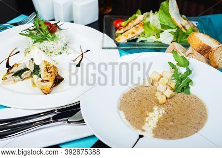 Multi-course Set Lunch. Mushroom Soup, White Fish Fillet With Herbs And Rice, Salad With Chicken Bre