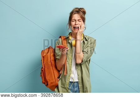Depressed Dejected Female Cries Holds Mobile Phone, Has Problem With Internet Connection, Checks Ema