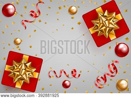 Beautiful Background With Christmas Gifts And Golden Serpentines