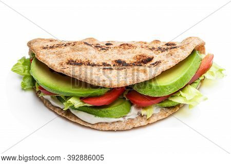 Folded  Wholemeal Flatbread With Vegetables Isolated On White