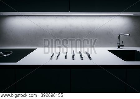 White Kitchen Worktop With Concrete Spatula On Wall And Illuminated Led Strip In Ceiling. There Is S