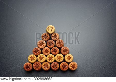 Wine Corks  With Pictures Of Stars And The Number Seventeen On A Gray Background Stacked In The Shap