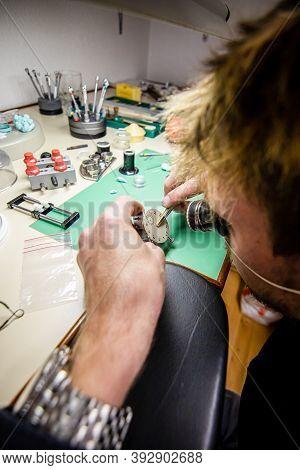 Watchmaker. Watch Repair Craftsman Repairing Watch. Swiss Watch Repair