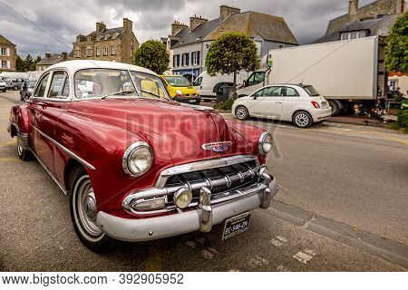 Saint Vaast, France - September Circa, 2020. A Red Vintage Shiny Beautiful Chevrolet Bel Air In The