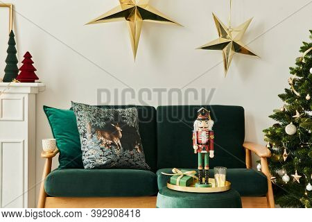 Stylish Christmas Living Room Interior With Green Sofa, White Chimney, Christmas Tree And Wreath, St