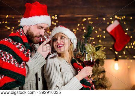 Idyllic Date. Man Woman Santa Claus Hats Cheerful Celebrating New Year. Romantic Ideas Celebration.