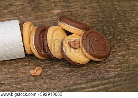 Biscuits On Wooden Background. With Heart Shapes, Love To Eat Biscuits Concept