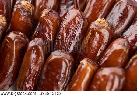 Creative Layout Made Of Dried Dates. Flat Lay. Food Concept. Fruits Dates. Dates Palm Fruit Isolated