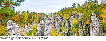 Prachov Rocks, Czech: Prachovske Skaly, Sandstone Rock Formation With Colorful Trees Of Autumn. View