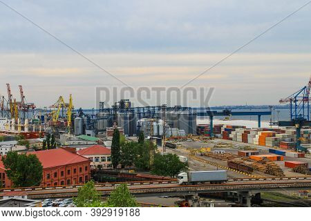 Hoisting Cranes, Transport Containers And Granaries At Cargo Sea Port In Odessa, Ukraine