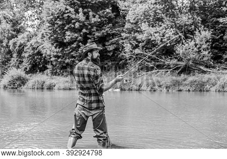 Keep Calm And Fish On. Mature Man Fly Fishing. Man Catching Fish. Fisherman With Fishing Rod. Hobby