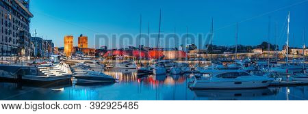 Oslo, Norway - June 24, 2019: Night View Embankment, Oslo City Hall And Moored Yachts Near Aker Bryg