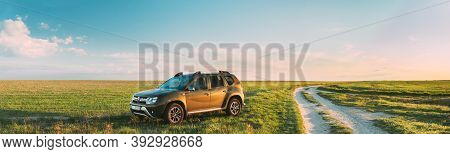 Gomel, Belarus - May 6, 2020: Renault Duster Suv Parked Near Countryside Road In Spring Field Countr