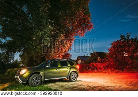 Dobrush, Belarus - August 4, 2020: Renault Duster Suv Dirty Car Parking On Street Under Night Starry