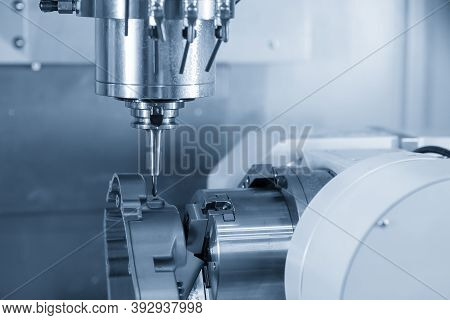 4-axis Cnc Machining Center Cutting The Automotive Parts. Hi-technology Manufacturing By Multi-axis