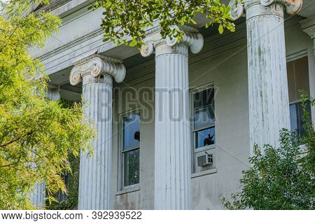 Columns And Broken Windows On Front Of Abandoned Home In Uptown New Orleans