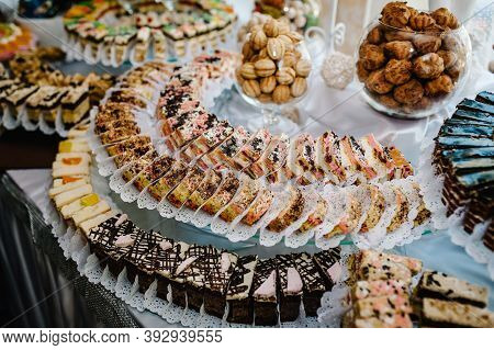 Sweet Table. A Plates Of Cakes And Muffins With Cream With Berries. Table With Sweets, Candy, Buffet